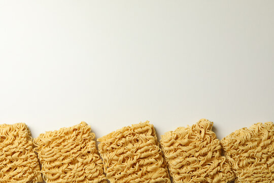 Flat lay with instant noodles on white background