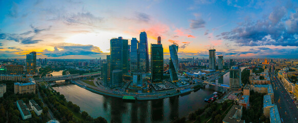 Large panorama view of summer Moscow with skyscrapers of Moscow-City - a business district on the embankment of Moskva River at sunset, Russia. Top view aerial cityscape from the drone.
