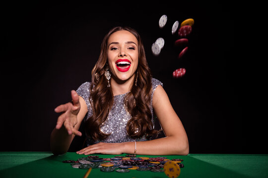 Photo of lady sit poker table throw chips stretch palm open mouth wear elegant dress isolated black color background