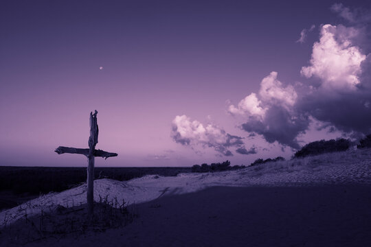 Purple landscape with wooden Cross or crucifix.  Concept for Lent Season, Holy Week, Palm Sunday and Good Friday.