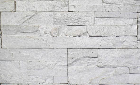 brick gray stone wall , white wool texure