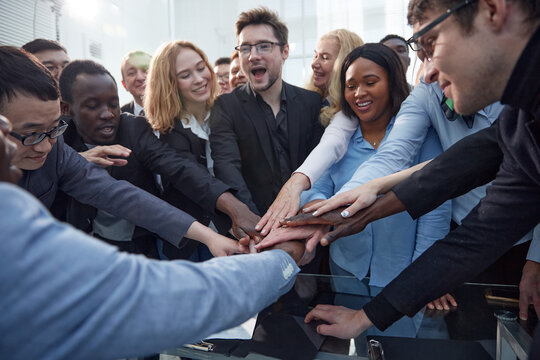 Business team stacking their hands together