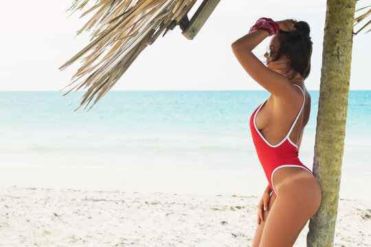Sexy and beautiful woman wearing red swimsuit on beach