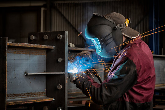 Factory welder doing his job close up