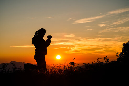 Woman praying in the morning.