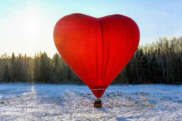Hot Air Balloon Flying Over Snow Covered Field