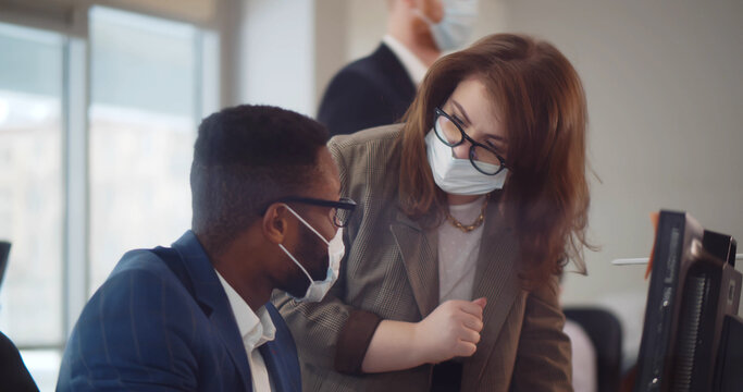 Business colleagues working in office with face mask during 2019-ncov pandemic