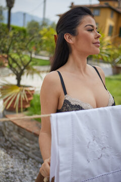 ITALIAN WOMAN KNOWS THE LAUNDRY IN HER GARDEN