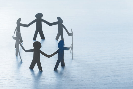 Arbeitskreis aus Papiermenschen - Teambuilding, Teamwork Konzept