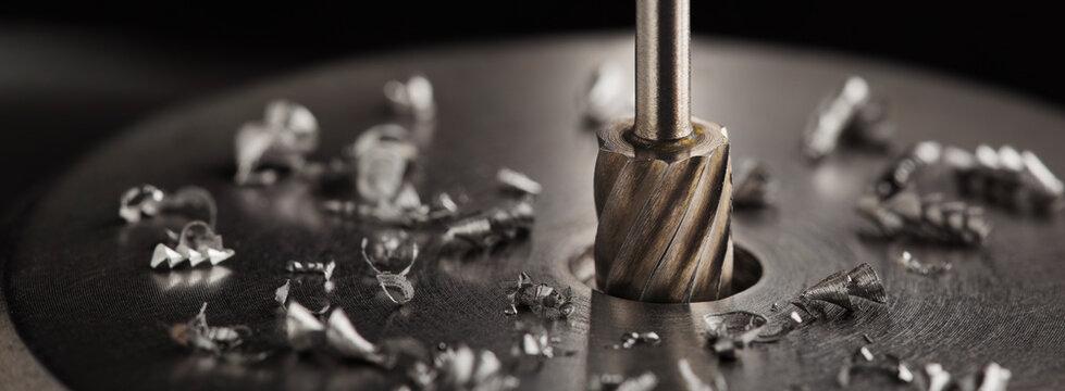 Milling сutter make sink in hole in steel billet. Locksmith work.