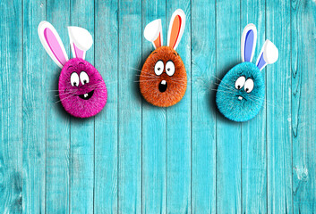 Easter eggs lie on a wooden background. Soft fluffy Easter eggs. Wood texture. Easter.