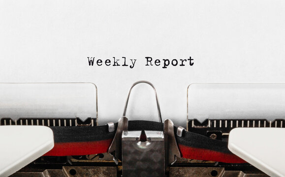 Text Weekly Report typed on retro typewriter