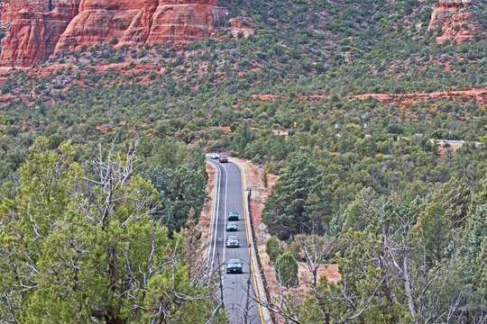 Traffic drives along State Route 179 as it cuts through National Forest just south of Sedona.