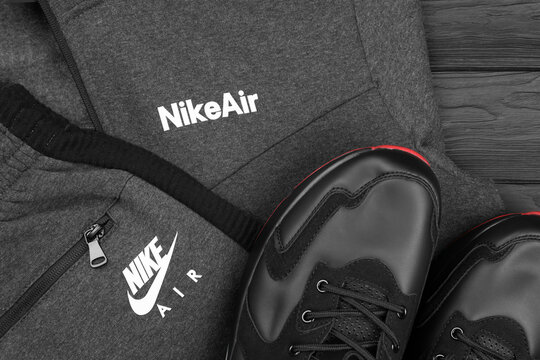 KHARKOV, UKRAINE - DECEMBER 20, 2020: Nike brand clothes and shoes sport wear kit. Nike is American multinational corporation engaged in manufacturing and worldwide marketing of clothes and footwear