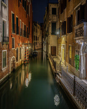 Scenic night view of a typical Venetian canal, Venice, Italy