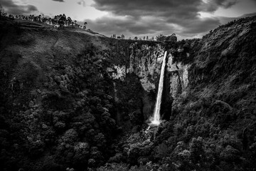 Aerial grayscale shot of cascading waterfalls Wall mural