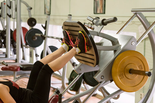 Low Section Of Woman Exercising In Gym