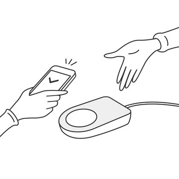 Holding smartphone over payment machine. Popular cashless and contactless payment method.
