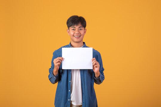 Image Happy Asian man holding message bubble on orange background.