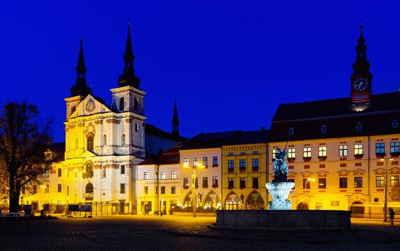 Autumn landscape of Jihlava main square with St. Ignatius Church, Municipal Hall and baroque fountain of Neptune at twilight, Vysocina Region, Czech Republic.