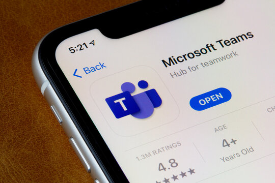Portland, OR, USA - Feb 10, 2021: Microsoft Teams app is seen in the App Store on an iPhone. Teams is a proprietary business communication platform, as part of the Microsoft 365 family of products.