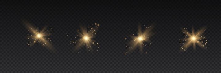 Fototapeta Set of bright Star. Yellow glowing light explodes on a transparent background. Transparent shining sun, bright flash