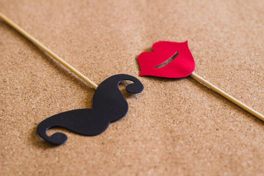 High Angle View Of Artificial Mustache And Lips On Cardboard
