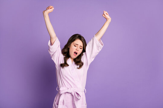 Photo of young attractive sleepy girl yawn stretch arms use under eye patch isolated over violet color background