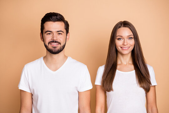 Photo of young attractive cheerful couple family happy positive smile isolated over beige color background