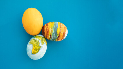 The planet Earth, and other celestial bodies, are drawn on the egg. Original idea for Easter.