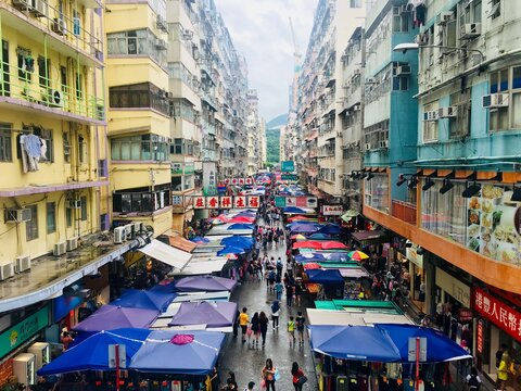 High Angle View Of People On Street Market Amidst Buildings In City