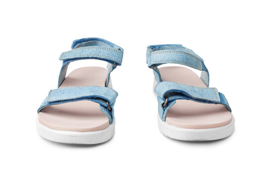 Blue female leather sandals, velcro straps, flat sole white background isolated close up front view, women sandal shoes, pair of fashion summer sandals, two comfortable boots, casual walking footwear
