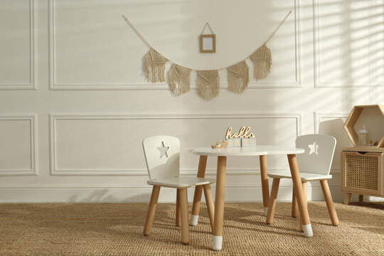 Modern child room interior with stylish furniture and accessories