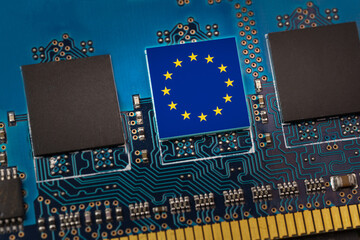 European Union flag in the center of a circuit board. Concept of leadership in technology, artificial intelligence or digital cryptocurrencies - fototapety na wymiar