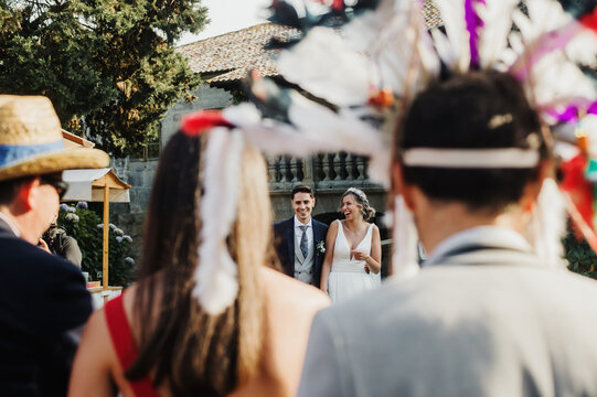 Couple laughing at their wedding with guests in disguise