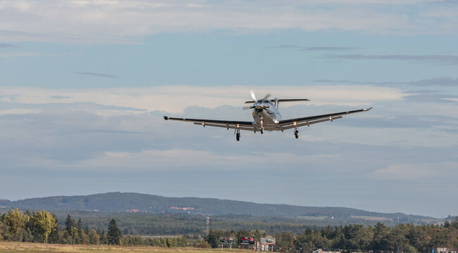 PRIBRAM, CZECH REPUBLIC - 1 October 2019. The Pilatus PC-12 NG single turboprop aircraft flies in the blue sky. The plane leaves from a small airport.