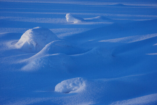 Image from Tjuvåsen Hill, part of the Totenåsen Hills, Norway, a snowy winter evening. Here snow pattern.