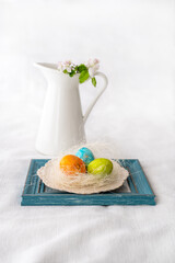 Easter concept. Easter decoration with painted and unpained easter eggs on a white background