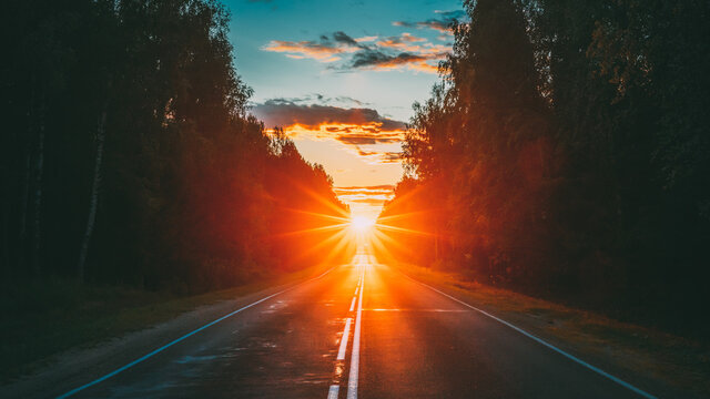 Sun Shine Above Asphalt Country Open Road In Sunny Morning Or Evening. Open Free Road In Summer Or Autumn Season At Sunny Sunset Or Sunrise Time