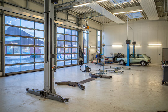 in big empty car workshop there are some car lifts