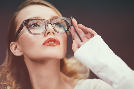 lady in in stylish glasses