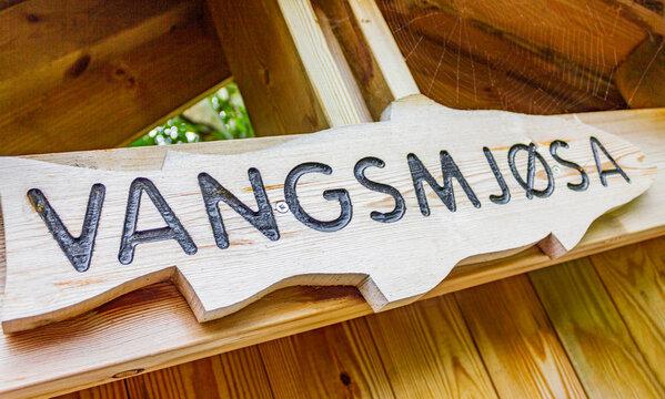 Lake Vangsmjøse in Vang Norway. Information nameplate made of wood.