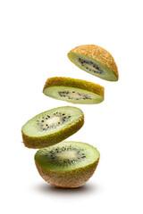 Fototapeta sliced kiwi fruit flying on white background