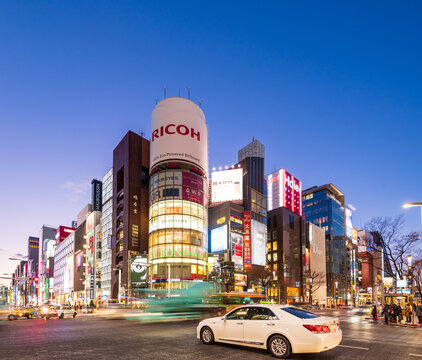 Tokyo, Japan - January 18, 2016: The famous Ricoh billboard building and night traffic at Ginza district at night and is one of the most famous city night views in Japan.