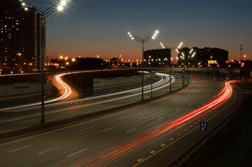 Night highway with light trails