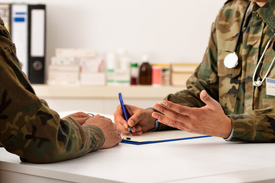 Cropped shot of a army doctor a giving his patient advice during a consult