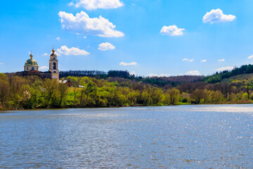 View of the beautiful lake and old orthodox church on a shore Wall mural