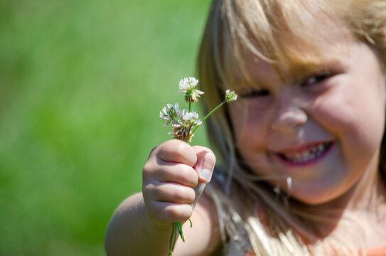 Young Girl And A Fist Full Of Flowers