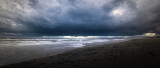 Fototapeta Long exposure shot of dark stormy clouds over the sea in Enoshima, Kanagawa Prefecture, Japan