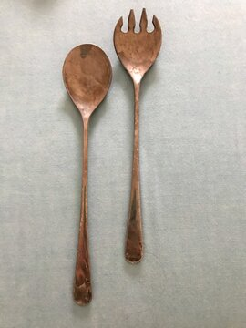 Directly Above Shot Of Spoon And Spork On Table